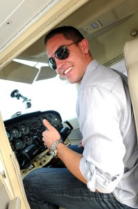 Ryan Rosales gives a thumbs up as he prepares to fly the first student solo in the aviation science program.