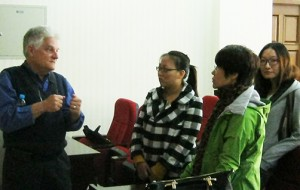 Dr. Fred Pontius (left) talks with faculty and students at the Chinese Agricultural University following the presentation.