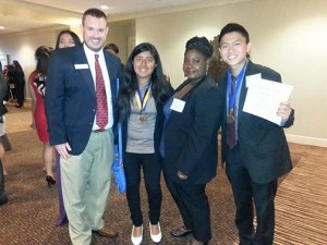 FBLA-PBL Inc. Professional Division National President David Jones celebrates with CBU PBL Members Diana Lopez, Khelsey Pellum and Joseph Chan