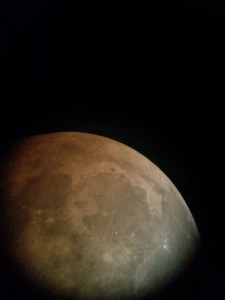 This photo was taken during the event with a cell phone camera pointed at the eyepiece of a telescope.