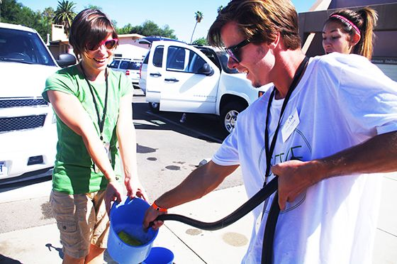 Madison Quiring and Joshua Flaherty work with other students to wash service vehicles for Sherman Indian High School.