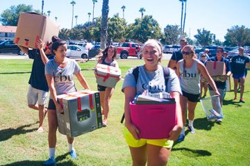 Members of CBU's water polo team help new team members move in on campus.