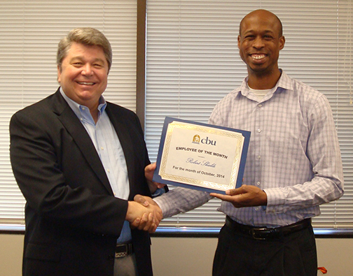 President Ronald L. Ellis presents Robert Shields the Employee of the Month Award for October.