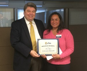 Dr. Ronald L. Ellis presents the Employee of the Month award to Lisa Logan.