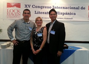 Dr. William Flores (right) with scholars who served on a panel he moderated