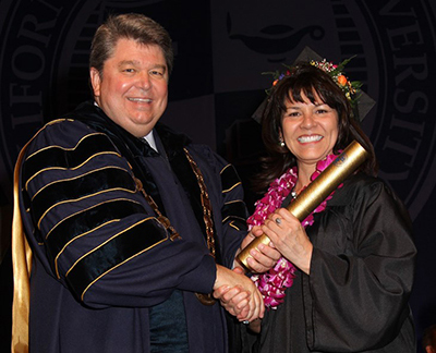 From left: Dr. Ronald L. Ellis and Lupe Solano