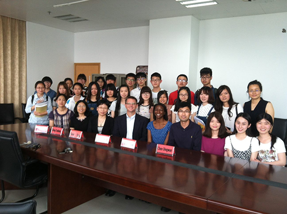 Dr. Chuck Sands with students at Zhejiang Medical College in China.
