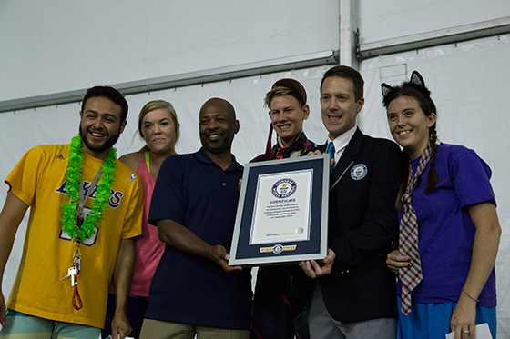 CBU is presented with a certificate from the Guinness World Records. From left: Zachary Partida, student; Ashley Coleman, student; Anthony Lammons, dean of students; Aaron Logerstedt, student; Philip Robertson, Guinness World Records adjudicator and Robin Lemmons, student.