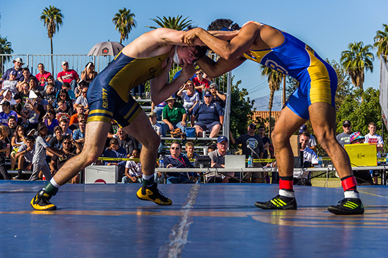 "Lancer wrestler Nolan Kistler (left) competes in ""Take It Outside II"" in front of more than 2,000 enthusiastic wrestling fans."
