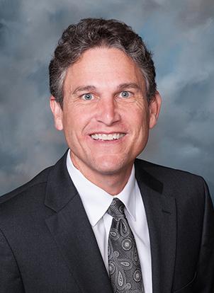 Dr. Kenneth Minesinger